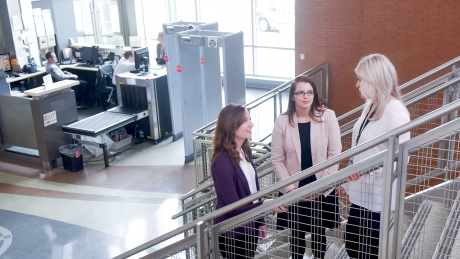 NC State psychology professor Sarah Desmarais, left, recent graduate Evan Lowder and alumna Sara Warren talk inside the Wake County Detention Center in Raleigh.