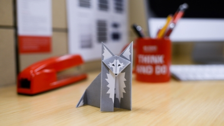 paper origami wolf on desk
