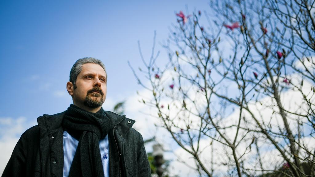 Wearing a jacket and scarf, Veljko Dubljevic looks off into the distance.