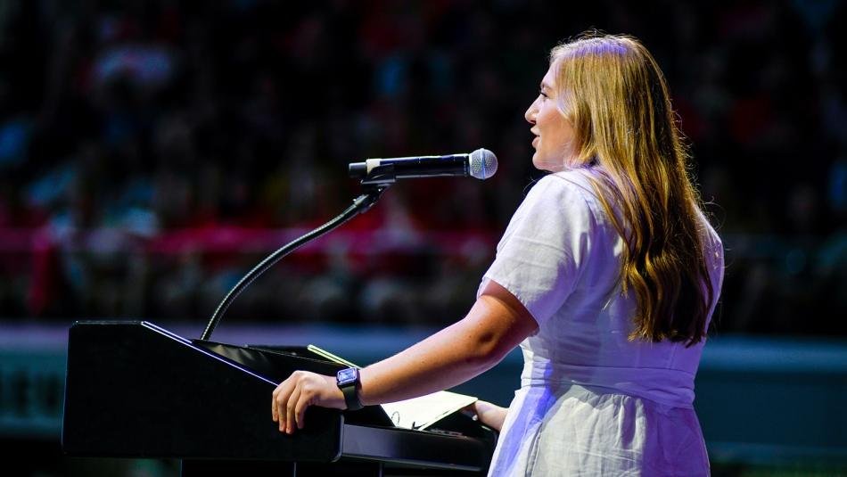 Emma Carter standing at podium