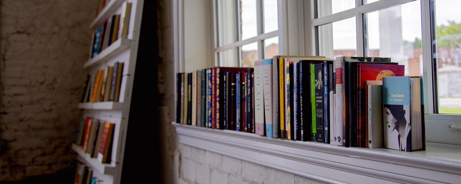 books on window sill inside Books and Beans