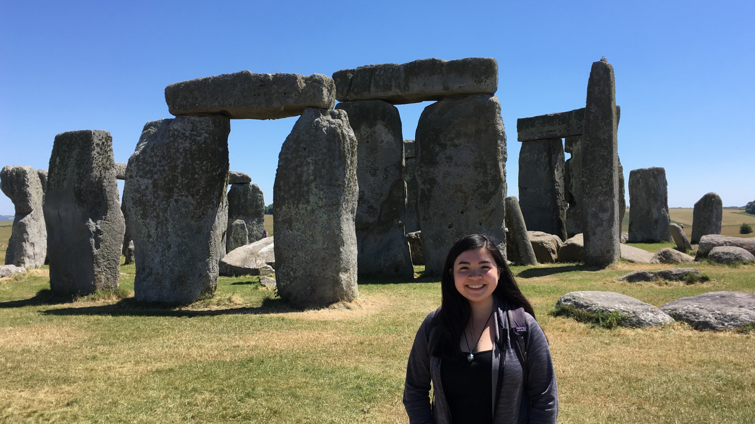 student standing in front of Stonehenge