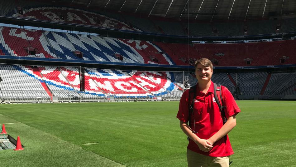 student standing inside Allianz Arena, home of FC Bayern Munich