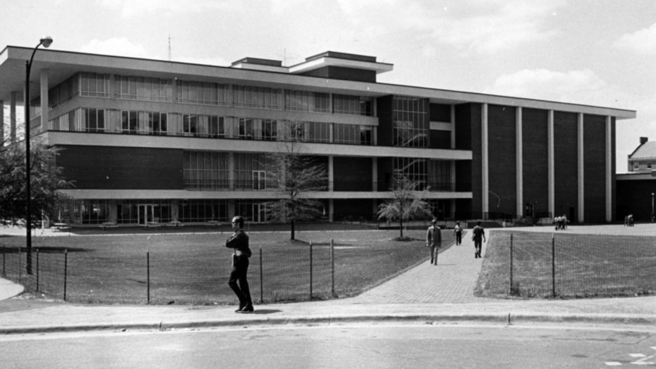 man walks by Talley Student Center in 1970s