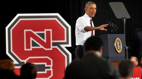 President Obama stands at a lectern beside an NC State block S as he announces the creation of PowerAmerica.