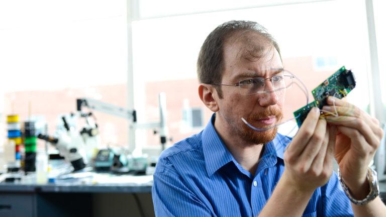 Dr. Alper Bozkurt does his research on Centennial Campus in EBII.