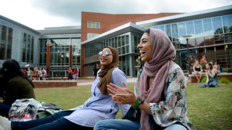 Students chat in the grass outside of Talley Student Union.