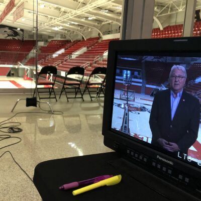 Chancellor Randy Woodson is recorded on video in Reynolds Coliseum for the Convocation program