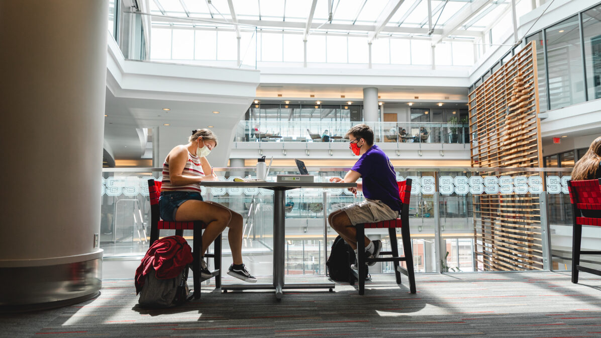Two students working on laptops in Talley Student Union