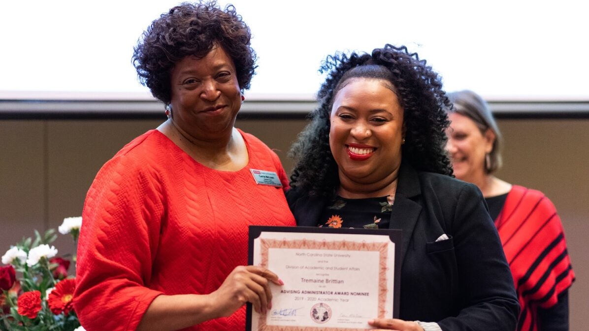 Two women holding a certificate