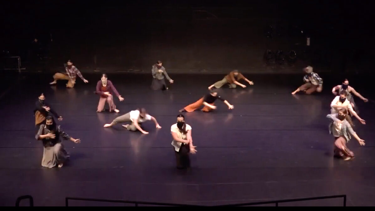Dancers perform on a stage