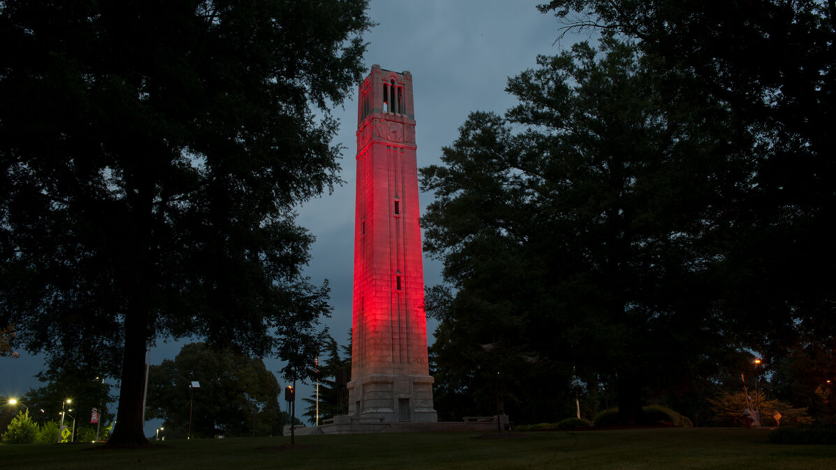 Bell tower lit up in red