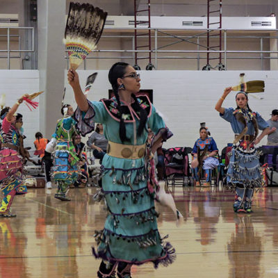 Native woman dances at the NC State Powwow