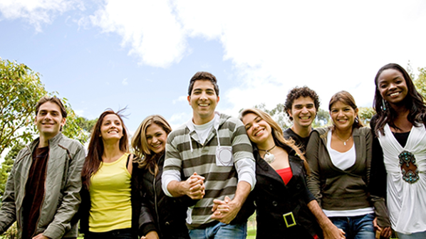 Diverse students standing in a group, smiling