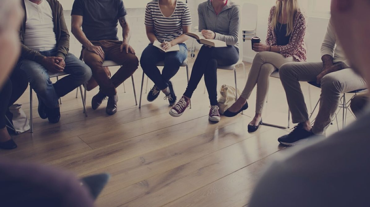 People sitting in a circle for a restorative practics