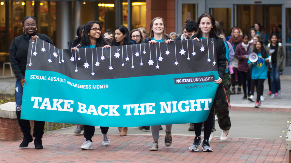 Students marching at Take Back the Night 2019