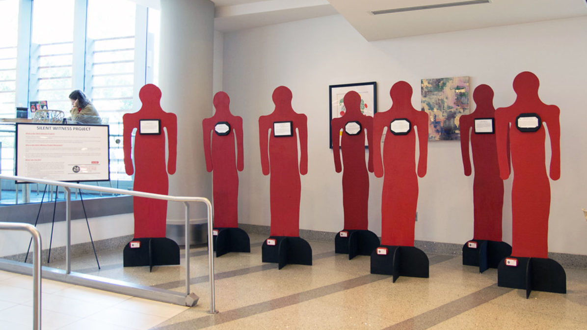 Red cutout figures from Silent Witness project