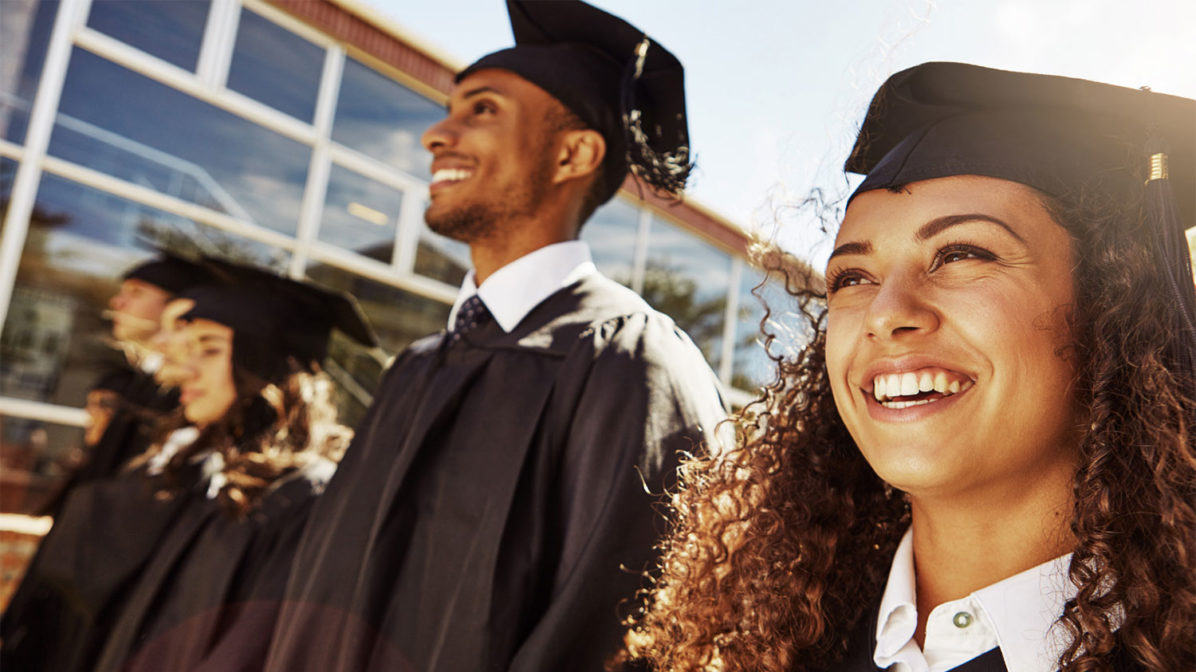New college graduates in their mortarboards and gowns
