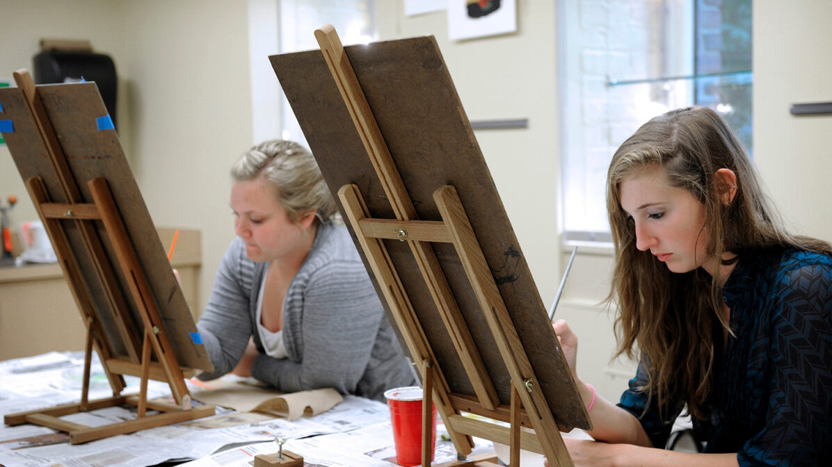 Students work on a painting during a class at the Craft Center